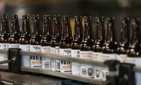 Beer gets bottled and labeled at the Back Forty Beer Co. in Gadsden. (Bernard Troncale / Alabama NewsCenter)