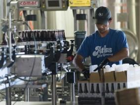 Efe Orgen packages cases of beer at the Back Forty Beer Co. in Gadsden. (Bernard Troncale / Alabama NewsCenter)