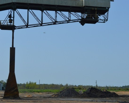 A pile of coal at Plant Greene County testifies to the plant's history, but its conversion to natural gas usage is complete. (Anna Catherine Roberson/Alabama NewsCenter)