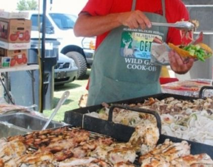 Barbecue cook-off teams vie for $20,000 in cash prizes during the Riverfest Barbecue Cook-off in Decatur.