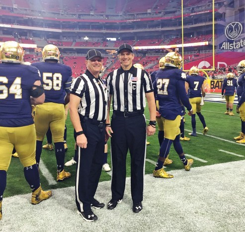 Steve Marlowe, right, with a fellow referee at the 2016 Fiesta Bowl. (contributed)