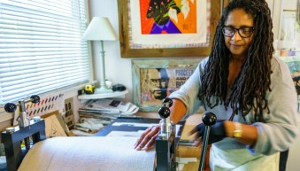 Artist Debra Riffe creates a handmade print. (Mark Sandlin/Alabama NewsCenter)