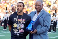Birmingham Mayor William Bell, right, recognizes Ludacris as the official celebrity ambassador for the 75th Magic City Classic. (Mykeon Smith / Alabama NewsCenter)
