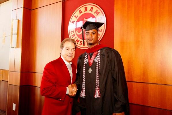Nick Saban poses with Brandon Greene, one of more than 30 Crimson Tide student-athletes graduation from the University of Alabama Saturday. (Robert Sutton/UA Athletics)