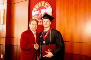 Nick Saban poses with Brandon Moore, one of more than 30 Crimson Tide student-athletes graduation from the University of Alabama Saturday. (Robert Sutton/UA Athletics)