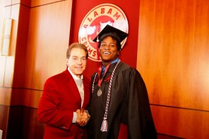 Nick Saban poses with Reuben Foster, one of more than 30 Crimson Tide student-athletes graduation from the University of Alabama Saturday. (Robert Sutton/UA Athletics)