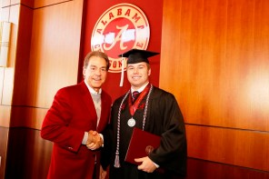 Nick Saban poses with Jake Long, one of more than 30 Crimson Tide student-athletes graduation from the University of Alabama Saturday. (Robert Sutton/UA Athletics)