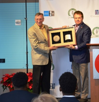 "Reeves Sims, left, receives the ""Volunteer of the Year"" award for the PGA Tour Champions from Bruno Event Team CEO Gene Hallman. (Michael Tomberlin / Alabama NewsCenter)"