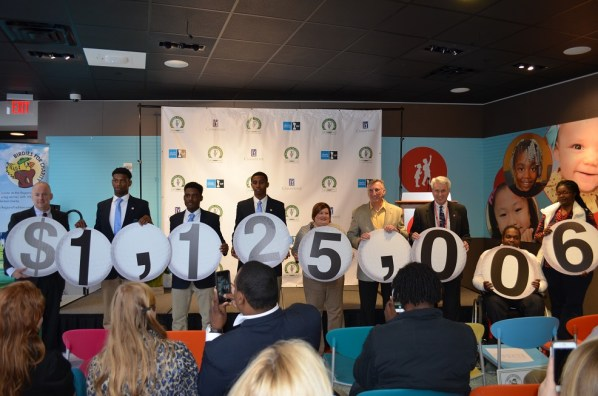 Charities reveal the total amount raised for charity in this year's Regions Tradition. (Michael Tomberlin / Alabama NewsCenter)