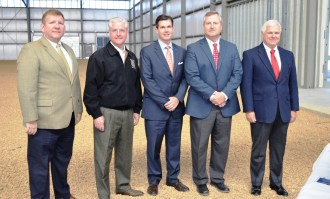 At the Dec. 2016 open house for a new spec building in Jasper were, from left, Russ Robertson, chairman of the Jasper Industrial Development Authority; Sen. Greg Reed; Patrick Murphy, Alabama Power vice president of Economic and Community Development; David Knight, director of the Walker County Development Authority; and Jasper Mayor David O'Mary. (Michael Tomberlin / Alabama NewsCenter)