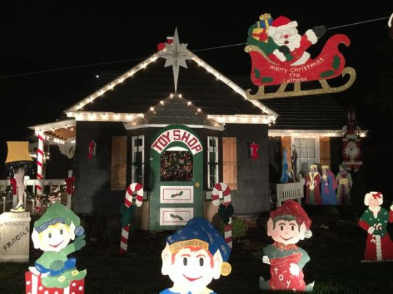 More than 30 wooden figures decorate the Lathams' home at 221 Magnolia St. (Donna Cope / Alabama NewsCenter)