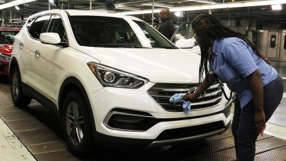Workers at Hyundai Motor Manufacturing Alabama put the finishing touches on a new Santa Fe. Alabama's auto industry is a prime example of the state's economic growth in recent years. (Jamie Martin/Governor's Office)
