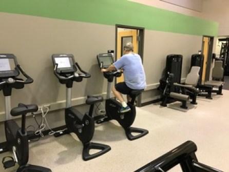 Chuck Osbun uses an elliptical machine. (Bob Shephard)