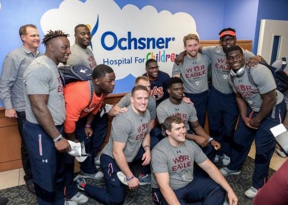 The Auburn football team visits patients at Ochsner Hospital for Children. in New Orleans. (Wade Rackley/Auburn Athletics)