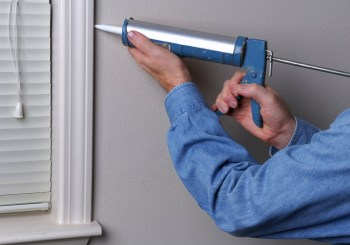 Caulking helps keep warm air in and cold air out in the winter. (iStock)
