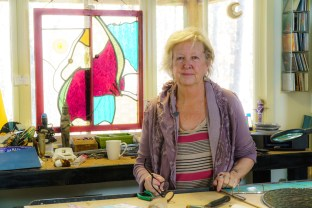 The stained glass bug bit Deborah Strawn early, and she has mastered the craft. (Mark Sandin/Alabama NewsCenter)