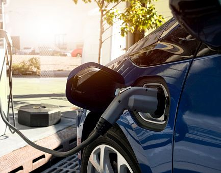 An electric car gets a recharge. (Contributed)