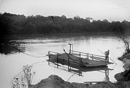 A historical photograph of the Gee's Bend Ferry in operation before the service was suspended in 1962. (Library of Congress)