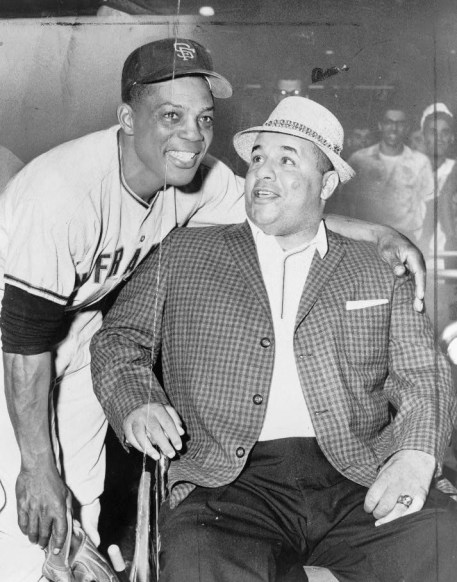 Willie Mays, standing, wearing baseball uniform, with arm around shoulders of Roy Campanella, 1961. (World Telegram & Sun photo by William C. Greene, Library of Congress Prints and Photographs Division)