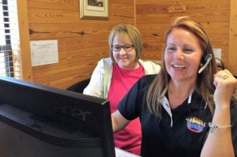 Kaila Fair (right) and Regina Word help make campers' stays both convenient and pleasant. (Donna Cope / Alabama NewsCenter)