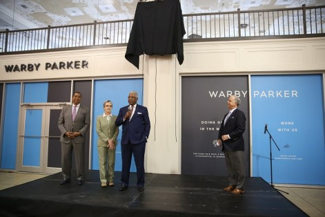 Birmingham Mayor William Bell (with microphone) speaks during the grand opening. David Silverstein, principal with Bayer Properties, right, and Birmingham City Council members Jay Roberson and Valerie Abbott look on. (contributed)