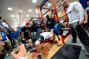 Alex Kozan works the bench at Auburn Pro Day. (Dakota Sumpter/Auburn Athletics)