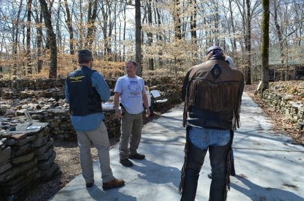 Trace Hendrix greets visitors to the wall. (Anne Kristoff / Alabama NewsCenter)
