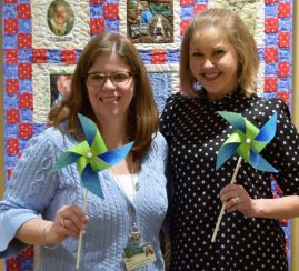 The duo show off their pinwheels, symbols of National Donate Life Blue and Green Day, celebrated on April 21 by the Alabama Organ Center, in honor of organ donors and recipients. (Donna Cope / Alabama NewsCenter)