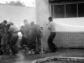 """During the Birmingham campaign of 1963, City Commissioner Eugene """"Bull"""" Connor jailed hundreds of protesters and authorized the use of fire hoses and police dogs on others. This image was one of many published in the mass media that raised a public outcry to end civil rights abuses in the South. (From Encyclopedia of Alabama, courtesy of The Birmingham News. All rights reserved. Used with permission.)"""