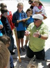 Founder Mike Reynolds teaches Share the Beach volunteers at the site of a sea turtle nest. (Share the Beach)