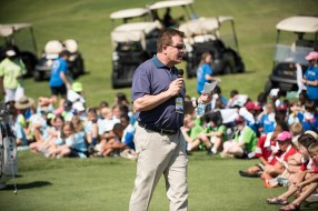 Regions Tradition executive director Gene Hallman talks with children about golf and values. (Christopher Jones/Alabama NewsCenter)