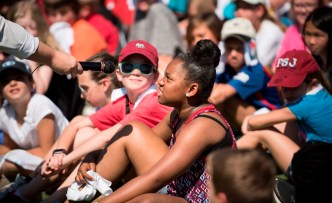 A student asks a question at the Regions Junior Clinic. (Christopher Jones/Alabama NewsCenter)