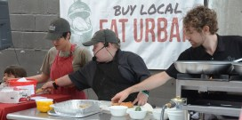 Fuller Goldsmith cooks at the Market at Pepper Place. (Karim Shamsi-Basha / Alabama NewsCenter)