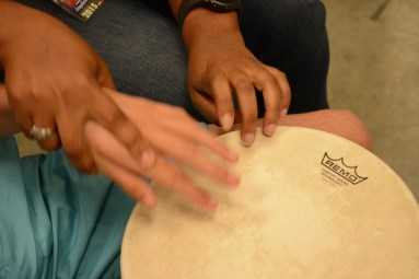 Synergy, a drum circle for special needs students, has helped develop coordination and self-esteem in the participants. (Karim Shamsi-Basha/Alabama NewsCenter)