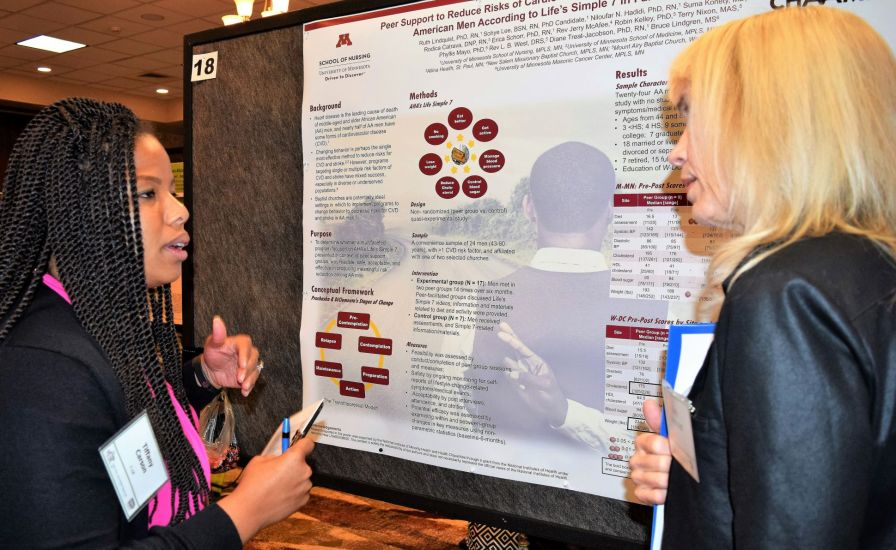 UAB's Dr. Tiffany Carson (left) discussed her study involving heart disease prevention in African-American men. (Donna Cope/Alabama NewsCenter)