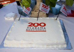 A cake with the Alabama 200 logo denotes the Alabama Bicentennial kickoff. (Keth Necaise)