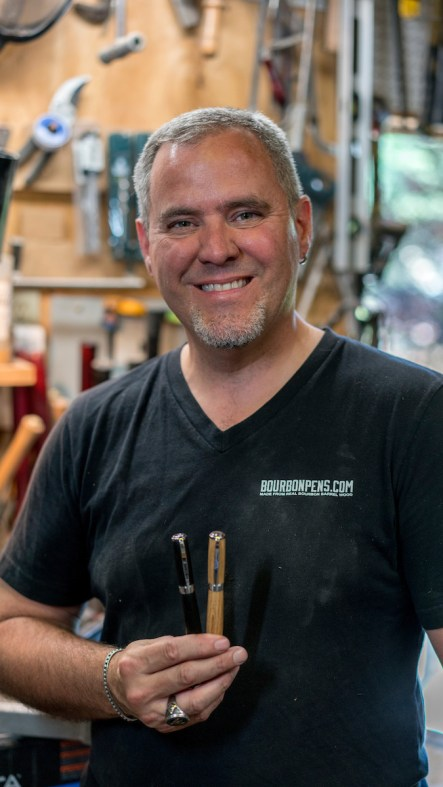 Joel Lockridge makes pens from all sorts of woods, from former bourbon barrels to bog wood from England. (Mark Sandlin/Alabama NewsCenter)
