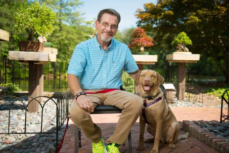 Benintende and his Lab, Rudy Hercules, enjoy the park. (Phil Free/Alabama NewsCenter)