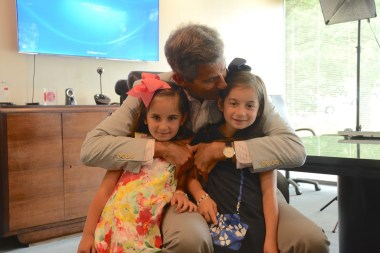 Jeffrey Bayer loves on his grandchildren Madison Goldberg, left, and Emory Goldberg. (Karim Shamsi-Basha / Alabama NewsCenter)