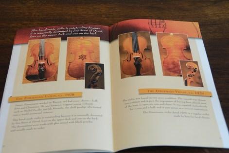 A few of the Violins of Hope. (Karim Shamsi-Basha / Alabama NewsCenter)