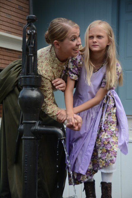 """Kaity Klinghard, 19, and Landri Kilpatrick, 8, play the roles of Anne Sullivan and Helen Keller in the Helen Keller Festival's production of """"The Miracle Worker."""" The lead actresses alternate performances of the emotionally demanding roles during the festival. (Karim Shamsi-Basha/Alabama NewsCenter)"""