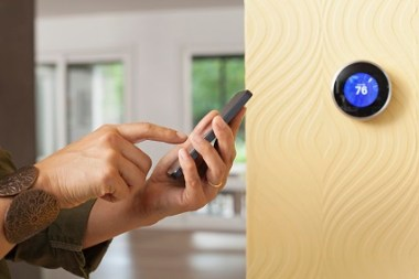 Set your thermostat higher and turn on ceiling fans to save money. (Getty Images)