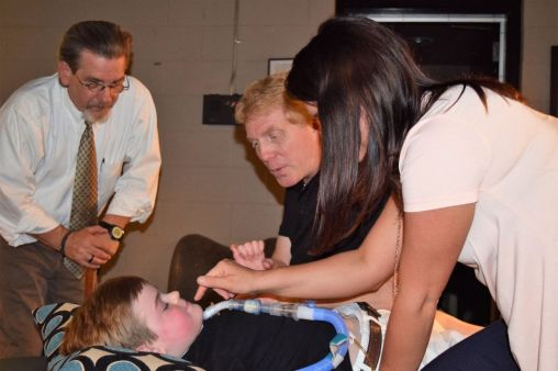 Hayden Hulsey during treatment, with (from left) Benintende, Bryant and Taylor Hulsey. (Donna Cope/Alabama NewsCenter)
