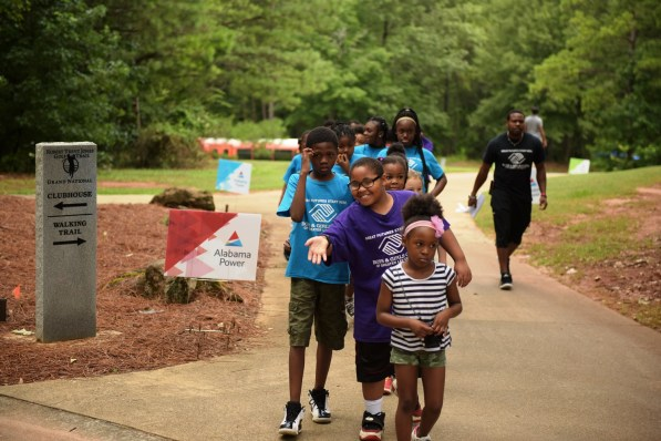The kids arrive for the Alabama Power Junior Clinic at Grand National golf course in Opelika. (Christopher Jones/Alabama NewsCenter)