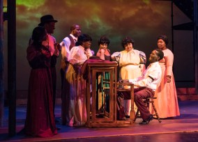 "Willie Williams at the piano surrounded by (L to R) Davida Tubbs, Da'Vontay Brown, Nate Blakely, Crystal Lassiter, Dorcas Britford, Ivan Taylor, Kiana Little in Theatre Tuscaloosa's upcoming production of ""Ragtime,"" running July 14-23 in the Bean-Brown Theatre. Photo by P. Solorzano."
