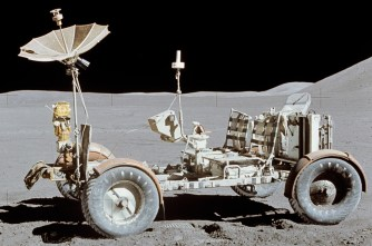 One of a series of images taken as a pan of the Apollo 15 landing site, taken by Commander Dave Scott in 1971. Featured is the Lunar Roving Vehicle at its final resting place. At the back is a rake used during the mission. Also note the red Bible atop the hand controller in the middle of the vehicle, placed there by Scott. (Photograph by Dave Scott, NASA, Wikipedia)
