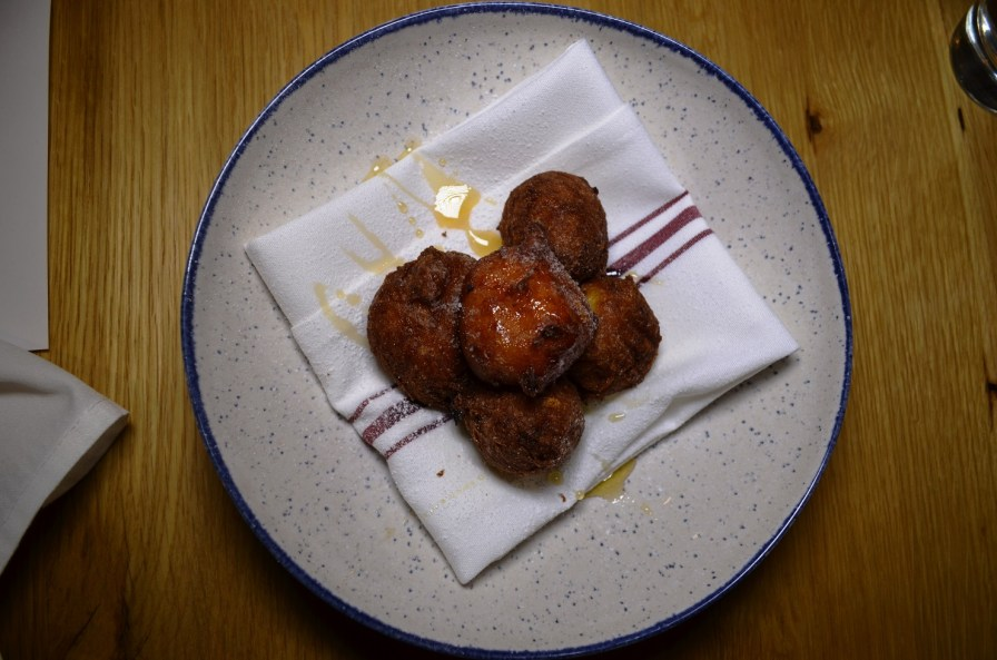 Ricotta fritters with local honey and sugar. (Michael Tomberlin / Alabama NewsCenter)