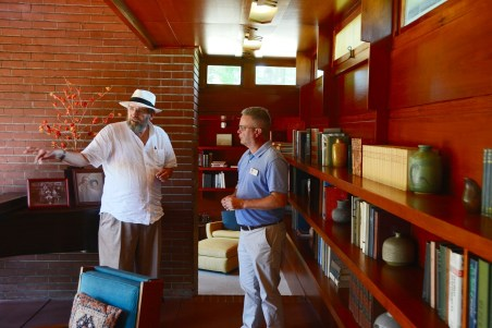 Alvin Rosenbaum revisits his childhood home and talks about his life there with site director Jeff Ford, who gives public tours of the house and tells visitors about its designer, famed architect Frank Lloyd Wright. (Karim Shamsi-Basha/Alabama NewsCenter)