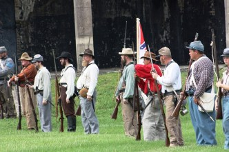 Infantry drill on the parade ground at Fort Morgan during the living history event on the 153rd anniversary of the Battle of Mobile Bay. (Robert DeWitt / Alabama NewsCenter)