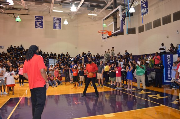 Nenê and James Harden of the Houston Rockets judge a shooting competition with Parker High School students. (Michael Tomberlin / Alabama NewsCenter)